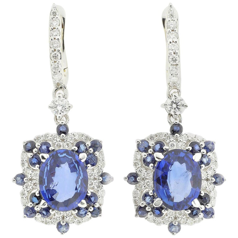 Drop Earrings Set with Diamonds and Blue Sapphires Set in 18 Karat White Gold For Sale