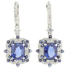 Drop Earrings Set with Diamonds and Blue Sapphires Set in 18 Karat White Gold