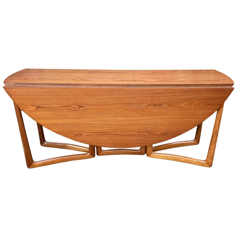 Drop Flap Teak and Brass Dining Table by Peter Hvidt for France & Søn For Sale