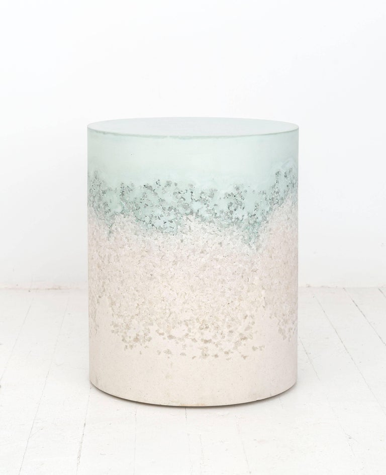 A layering of cement and crushed aggregates, the made-to-order drum consists of an hand-dyed celadon cement top and a packed white rock salt bottom. Poured by hand over the jagged minerals, the celadon cement merges the materials to create a unique