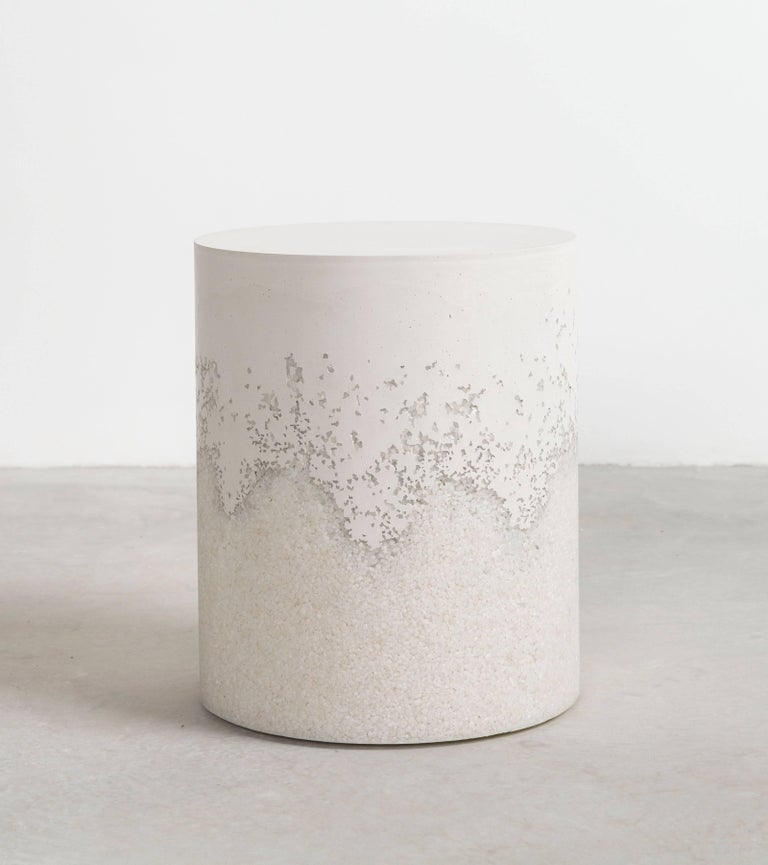 A layering of cement and crushed aggregates, the made-to-order drum consists of an hand-dyed white cement top and a packed crystal quartz bottom. Poured by hand over the jagged minerals, the white cement merges the materials to create a unique