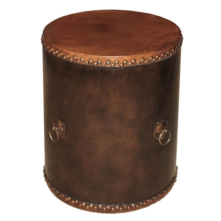 Contemporary wood and leather drum can be used as a side table next to a lounge chair or as a plant stand.