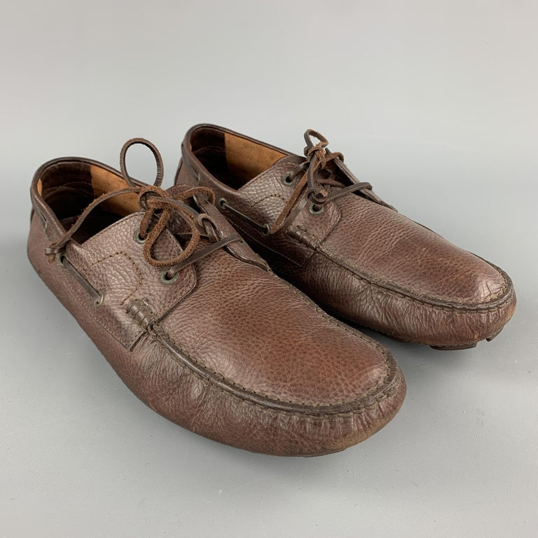 DSQUARED2 loafers come in brown leather with woven tie up front. Made in Italy.  Excellent Pre-Owned Condition. Marked: IT 43  Outsole: 11.75 x 3.5 in.