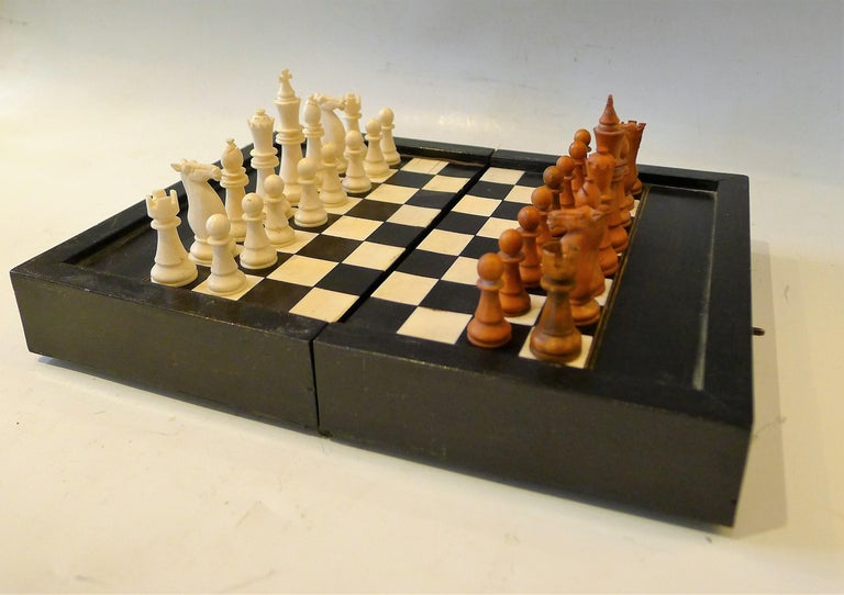 Dual chess and Backgamon wooden travel set. Game pieces in ebony and bone. Nice claps.