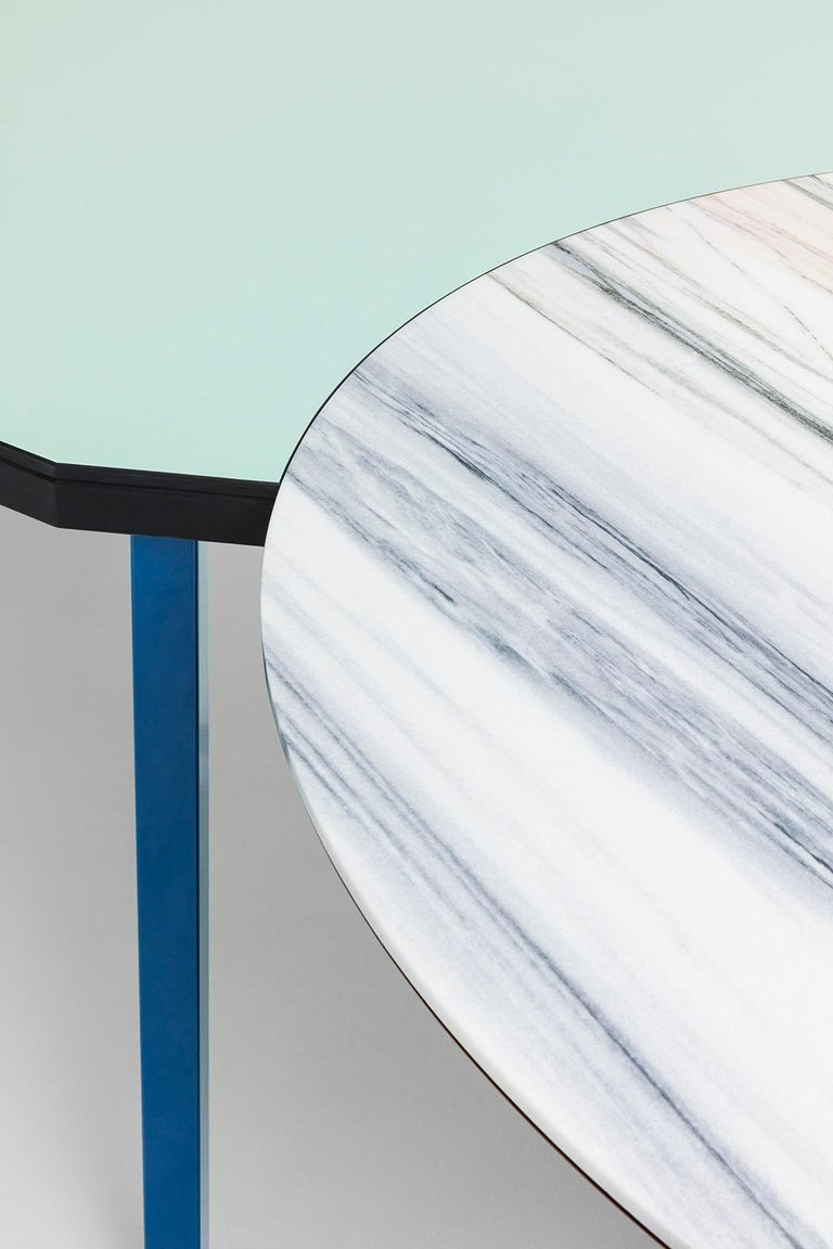 Duale table is in fact two tables in one: the round top is in Lasa white marble, taken from Croda di Jenn quarries at 1500 meters above sea level, the rectangular top (cm 128 x 186) is made laminate. The huge support structure consists of an