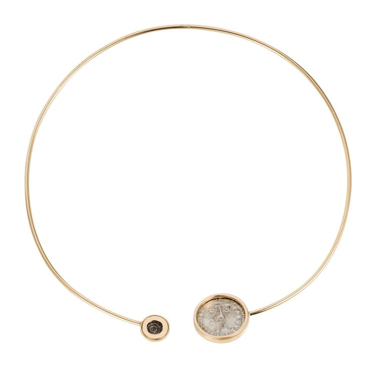 This DUBINI coin choker from the 'Empires' collection features an authentic Roman Imperial coin minted circa 210 - 211 A.D. and an authentic Persepolis coin minted circa 1st Century B.C. set in 18K yellow gold.   * Due to the unique process of hand