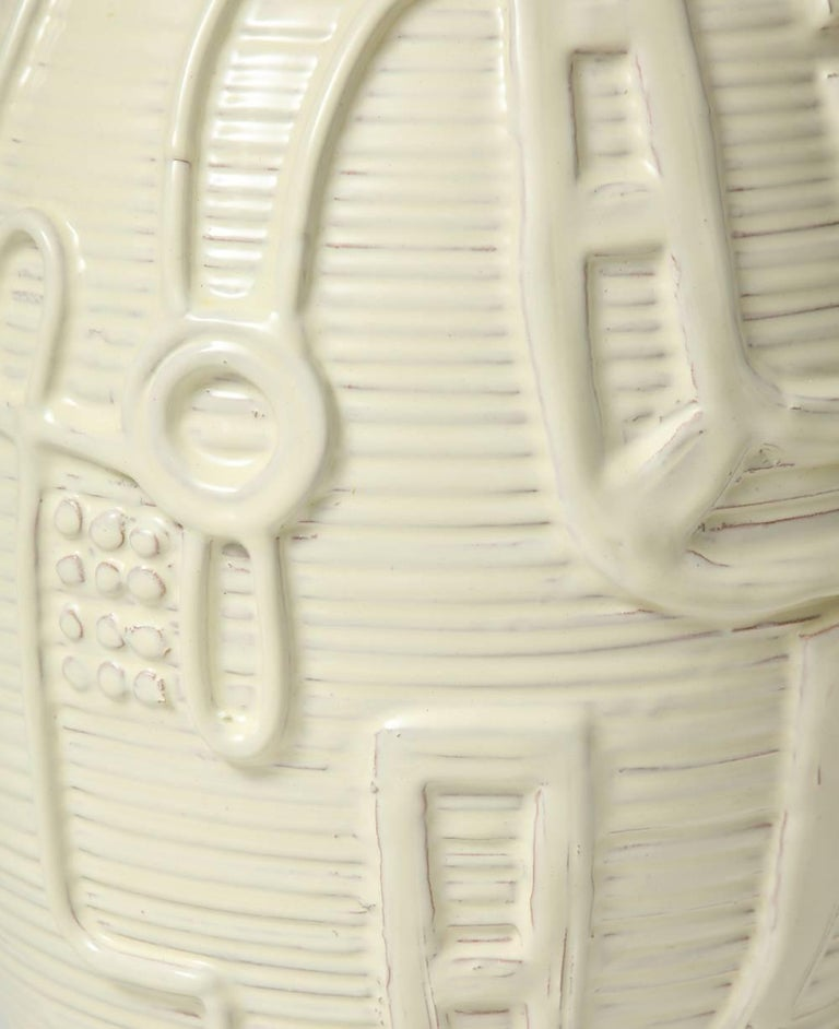 Large-scale ceramic bottle by Duca di Camastra. Beautiful and large terra cotta bottle form with incised lines and hand-applied decoration. Creamy-white glaze, and signed on underside.