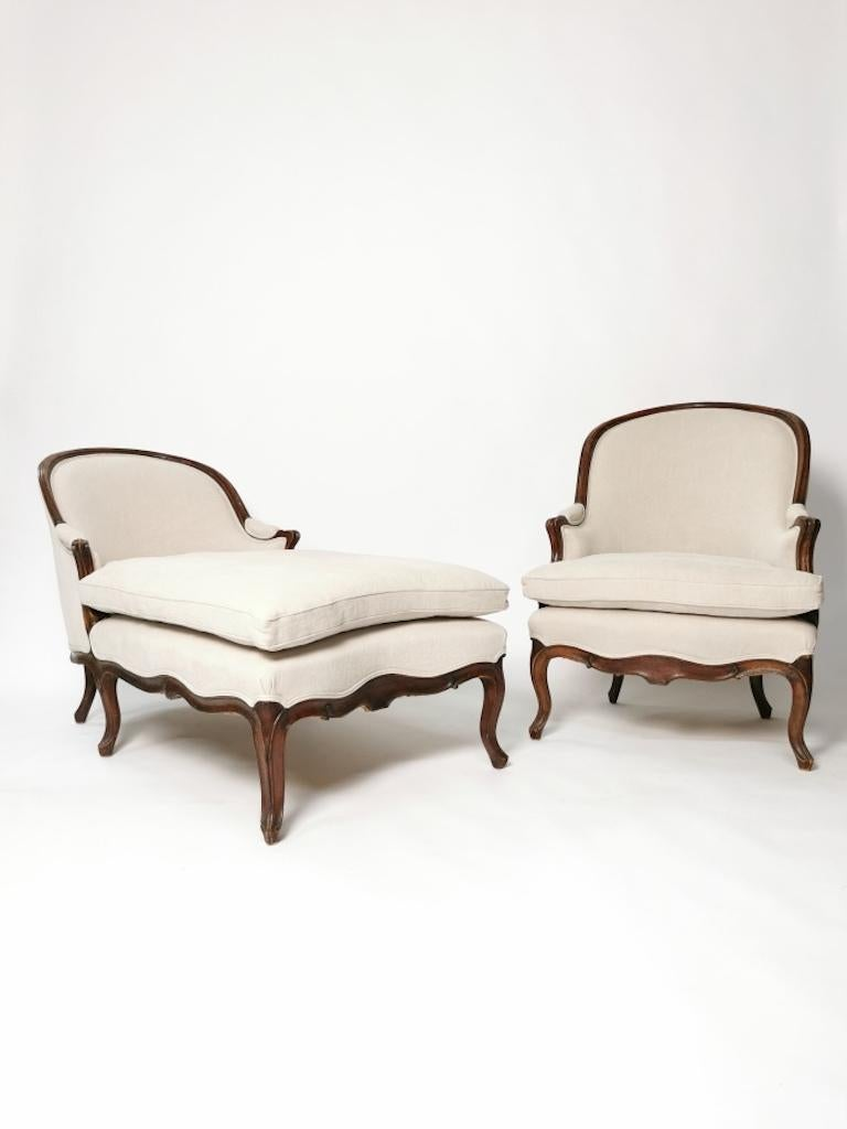 A Louis XV walnut Duchesse Brisée, mid-18th century.