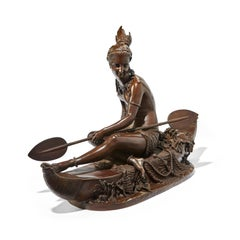 A Fine Patinated Bronze of a Native American Indian on a Canoe