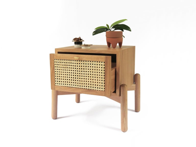 The Dumas nightstand is manufactured in solid white oak with a wicker drawer. The wicker caning and the carpentry are made by Mexican craftsmen. This bedside table is a contemporary Mexican piece and was originally designed for small spaces.  We