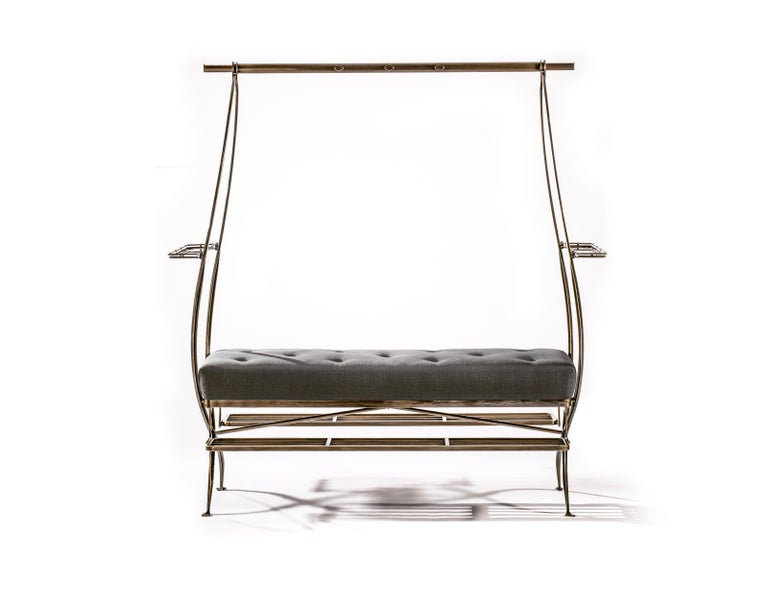 Bronze-plated steel framed dressing bench with upholstered seat, extending superstructure and foldable footrests.  B.B. - The sinuous form merges into perfect valet function. This piece works well when placed centrally in a dressing room where it