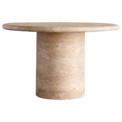Dume Pedestal Carved Travertine Round Table by Kelly Wearstler