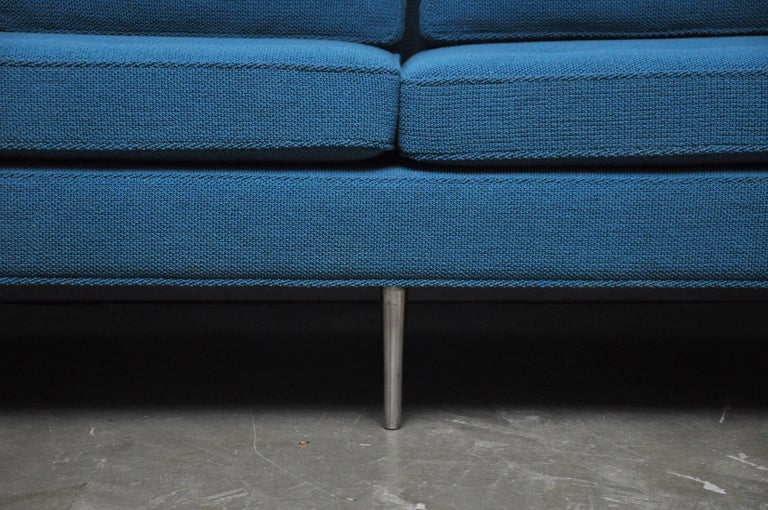 Iconic sofa designed by Edward Wormley for Dunbar. Fully restored. Polished nickel legs with new Knoll Aegean/turquoise bouclé fabric. New foam seat cushions with down filled back cushions.