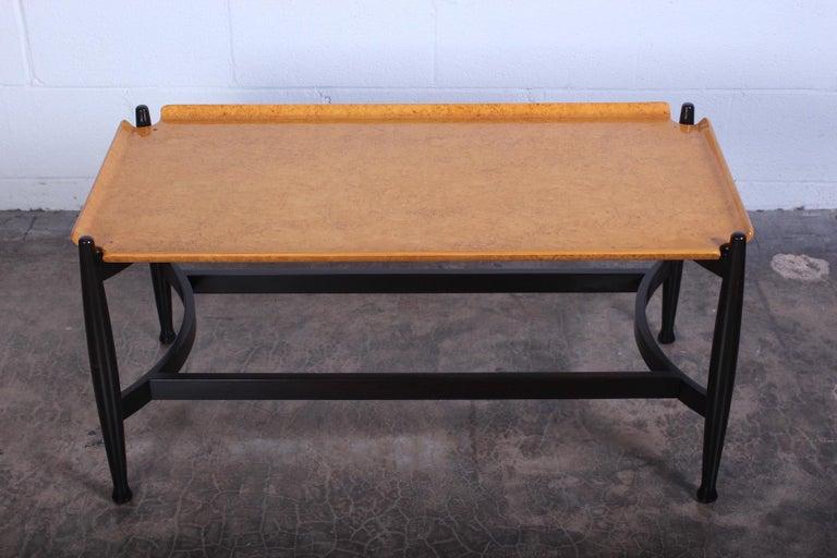 A rare burled birch trey table with ebonized base. Designed by Edward Wormley for Dunbar.
