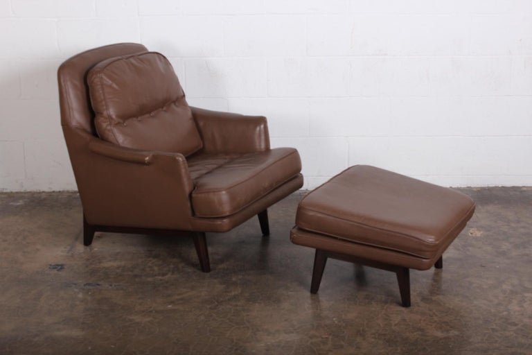 A Dunbar lounge chair and ottoman model 484 designed by Roger Sprunger. Mahogany frame with original leather.