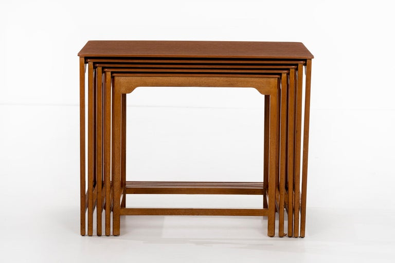 Wormley for Dunbar set of five nesting tables, model, 4785 Mahogany frames with scalloped designed apron with solid walnut top. Gold metal Dunbar label on underside. Measures: 12