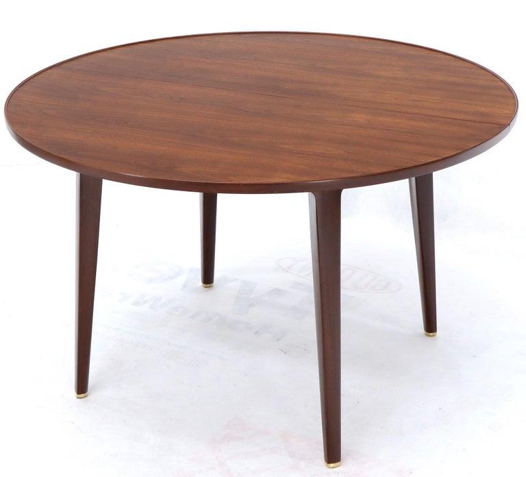 Mid-Century Modern Edward Wormley for Dunbar round dark walnut dining room table with 2 x 15