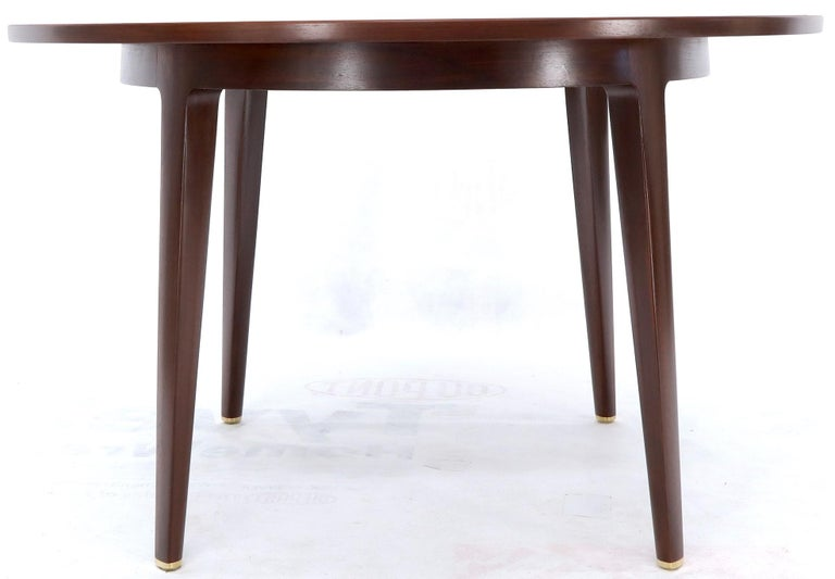 Lacquered Dunbar Round Walnut Dining Table with 2 Extension Boards Leafs Racetrack Shape For Sale