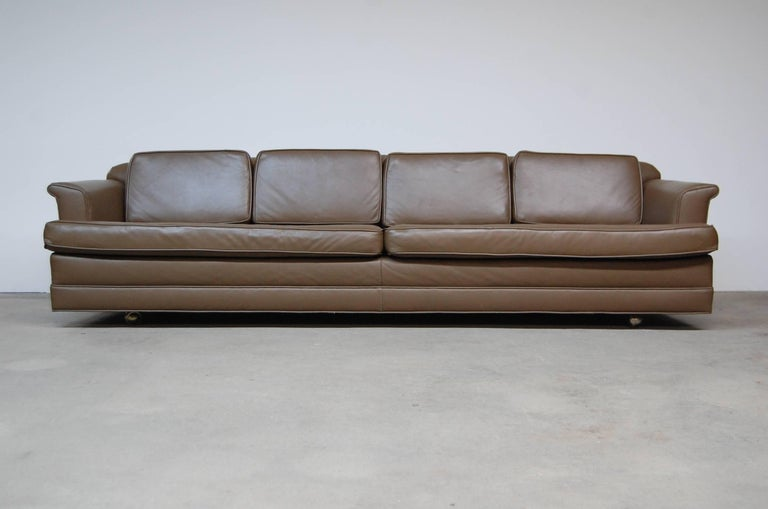 Dunbar sofa model 488, designed by Edward Wormley, in leather. Castors on front, legs in rear. Reupholstered in leather within the past ten years. Measures: Arm height is 21.5