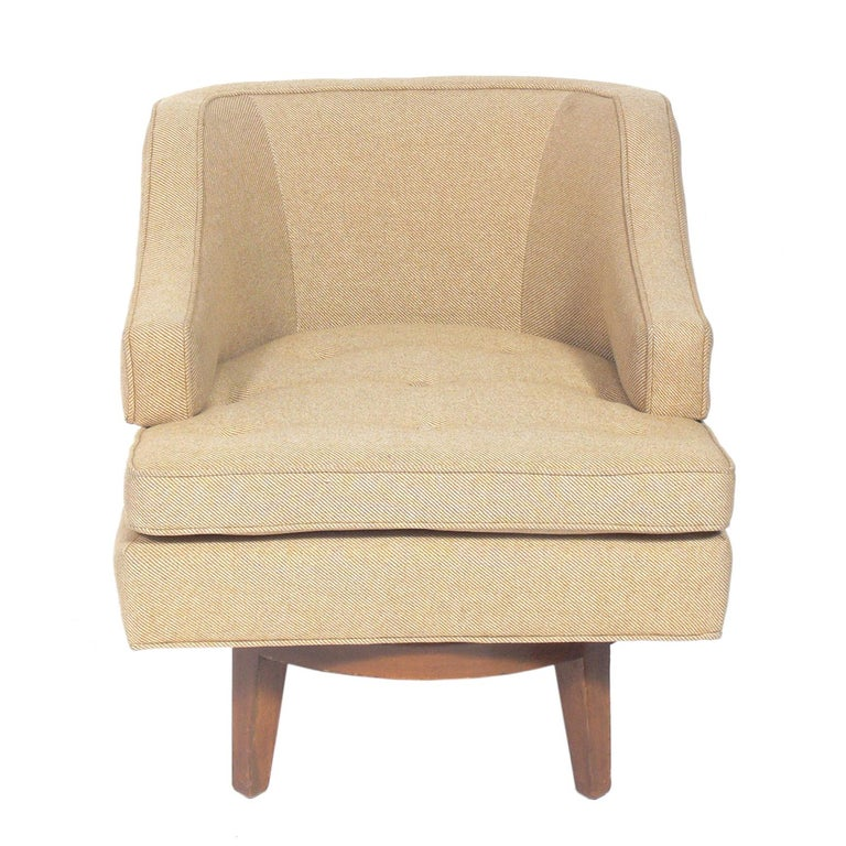 Curvaceous swivel lounge chair, designed by Edward Wormley for Dunbar, American, circa 1950s. This piece is currently being refinished and reupholstered and can be reupholstered in your fabric and refinished in your choice of color. The price noted