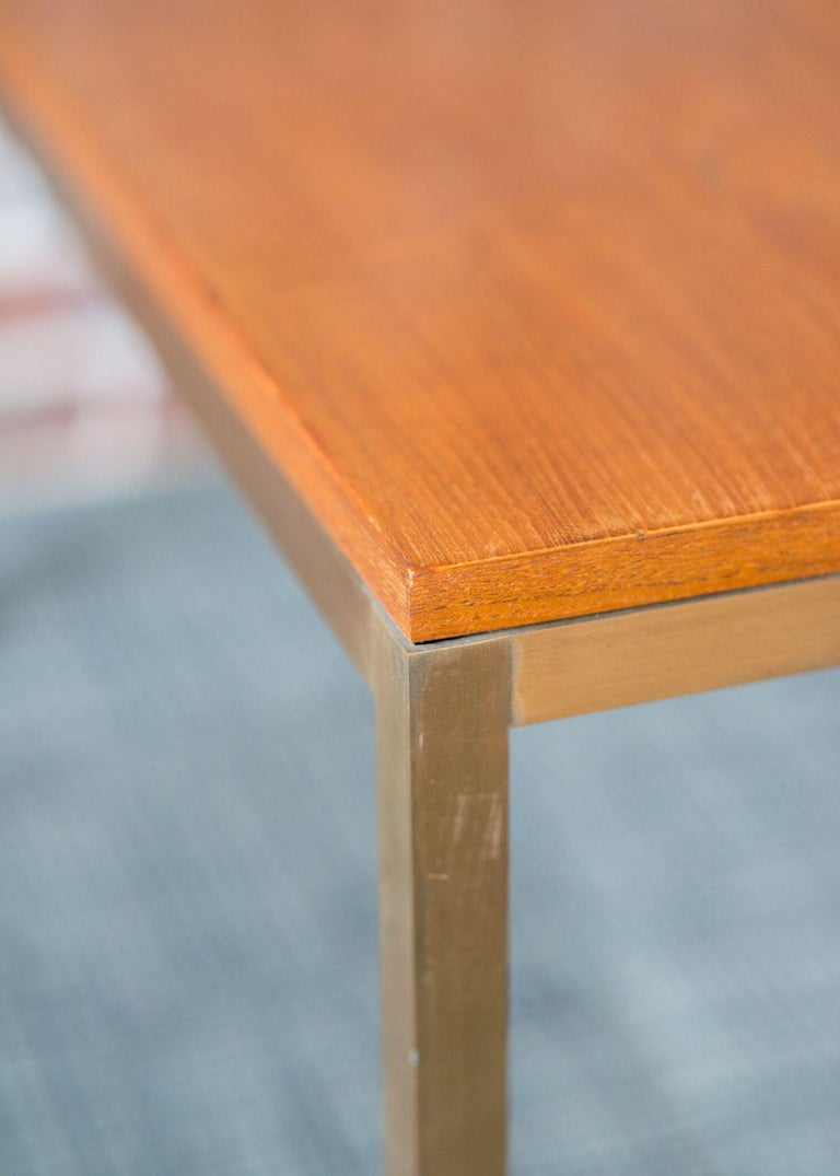 Dunbar #874 custom table  Natural teak top table with brass legs and teak feet  Sturdy table with clean lines