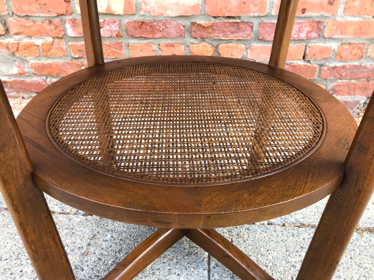 Dunbar Two-Tier Walnut Occasional Table with Cane Shelf In Good Condition For Sale In Hudson, NY