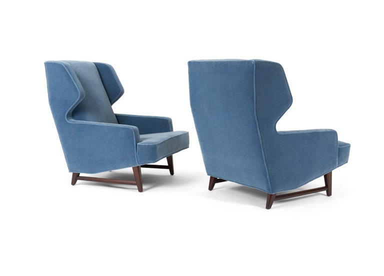 Sculptural pair of wing back lounge chairs by Edward Wormley for Dunbar. Fully restored. Refinished walnut bases. 100% angora mohair over new foam.