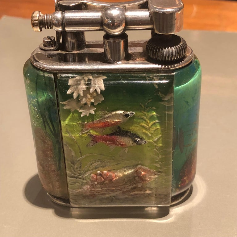 One of the most iconic lighters from Dunhill. The aquarium lighter has garnered an extraordinary reputation as one of the most unique luxury items to own.  Ben Shillingford (1904-2000) worked for Dunhill in the 1950s and perfected the art of