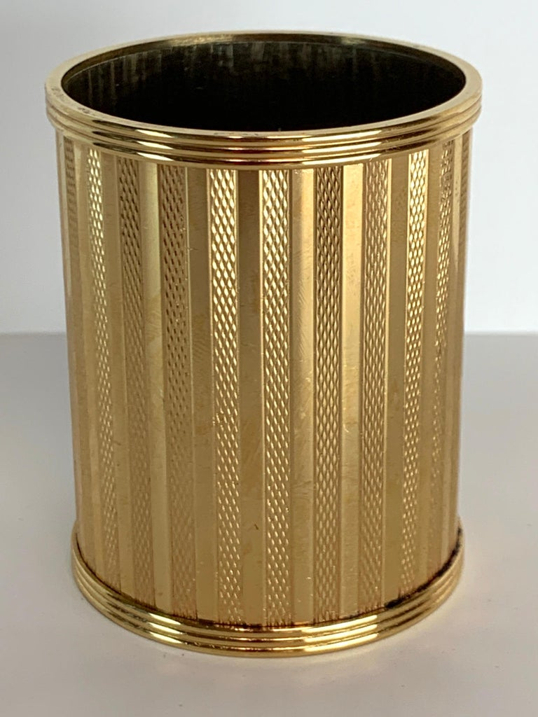Dunhill gold-plated smoking stand, Paris, circa 1950, beautifully crafted, high quality, with continuous decoration solid and engine turned stripes, very heavy gold plating, presents beautifully.