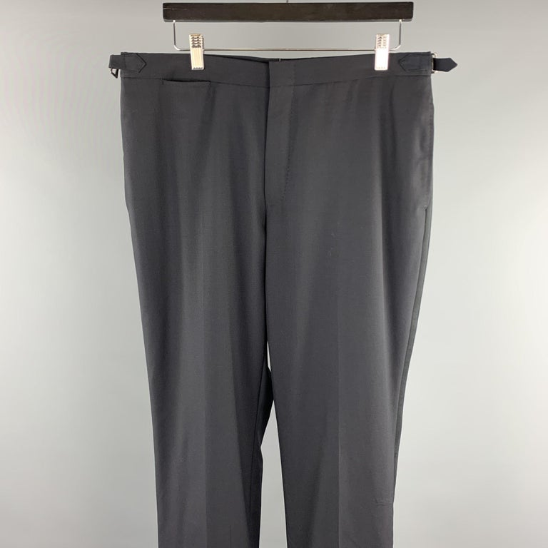 DUNHILL dress pants comes in a black wool featuring a tuxedo style, side tabs, and a zip fly closure.   Excellent Pre-Owned Condition. Marked: ( No Sized Marked )  Measurements:  Waist: 34 in. Rise: 10 in.  Inseam: 32 in.
