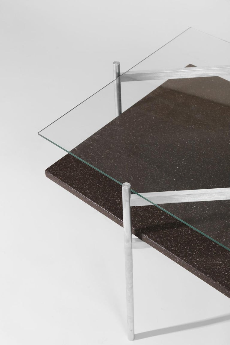 Made to order. Please allow six weeks for production.  Aluminium frame / clear glass / black mosaic  The Duotone furniture series is based on a modular hardware system that pairs sturdy construction with visual lightness and a range of potential