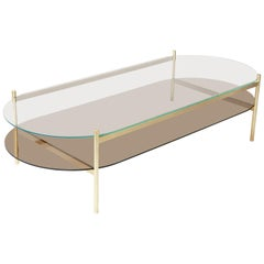 Duotone Pill Coffee Table, Brass Frame / Clear Glass / Bronze Glass