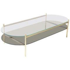Duotone Pill Coffee Table, Brass Frame / Clear Glass / Smoked Glass