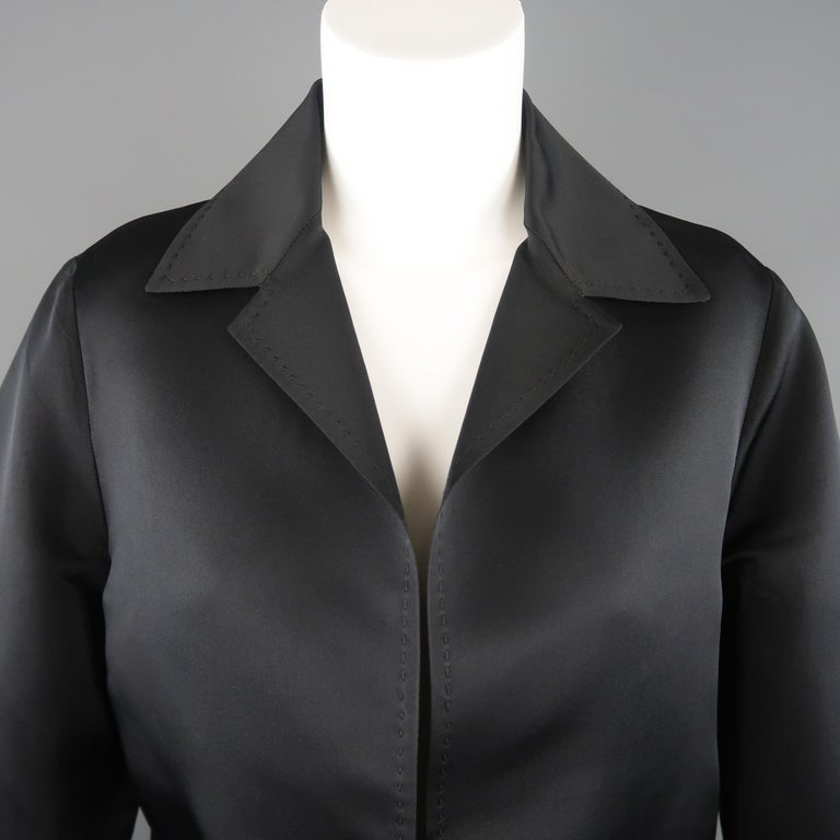 DUSAN jacket comes in black silk satin with a pointed collar, slanted pockets, open front, and top stitching throughout. Made in Italy.   Excellent Pre-Owned Condition. Marked: M   Measurements:   Shoulder: 16 in. Bust: 46 in. Sleeve: 24 in. Length: