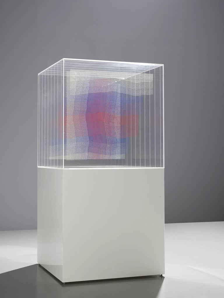 Artwork, wooden pedestal with perspex cube and layers in blue white and red by Maria Westra, The Netherlands, 1985.