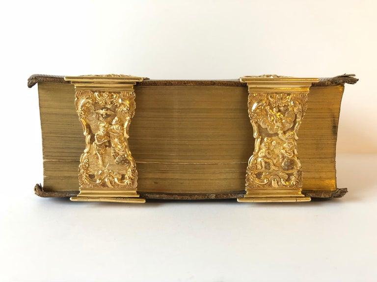 The gold clasps with maker's mark of Nicolaas van Wijk, Amsterdam, 1788 The bible: the old and new book by Nederlandsche Bijbel - Compagnie te Amsterdam, J. Brandt en Zoon, en P. Proost te Haarlem, Johannes Enschedé en Zonen 1853.  The four small