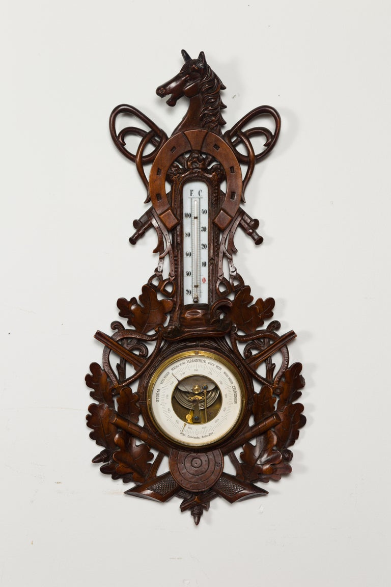 A Dutch carved wooden barometer from the late 19th century, with horse motif, signed by Gebroeders Caminada, Rotterdam. Hand carved in the Netherlands by the Gebroeders Caminada Company established in Rotterdam in 1856, this wooden barometer
