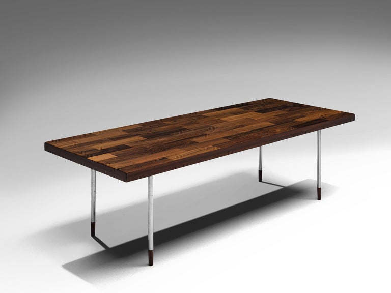Fristho, coffee table, rosewood and stainless steel, the Netherlands, 1960s  The rectangular top is made with rosewood veneer slats, in wonderful different tones. The warm expression of the rectangular top beautifully contrasts to the thin tubular