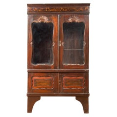 Dutch Colonial 19th Century Wooden Armoire with Carved Motifs and Glass Doors