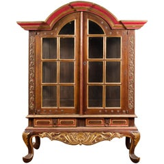 Dutch Colonial Early 20th Century Bonnet Top Gilded Cabinet with Glass Doors