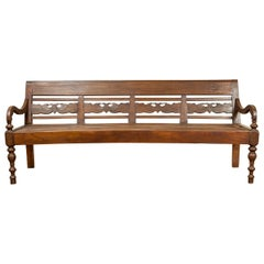 Dutch Colonial Late 19th Century Bench with Carved Back and Scrolling Arms