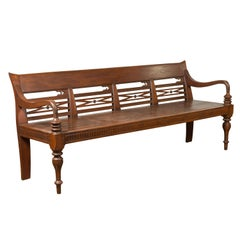 Dutch Colonial Late 19th Century Bench with Pierced Back and Scrolling Arms