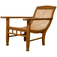 Dutch Colonial Vintage Plantation Lounge Chair with Curving Seat and Rattan