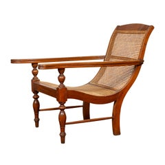 Dutch Colonial Vintage Teak Plantation Lounge Chair with Curving Seat and Rattan