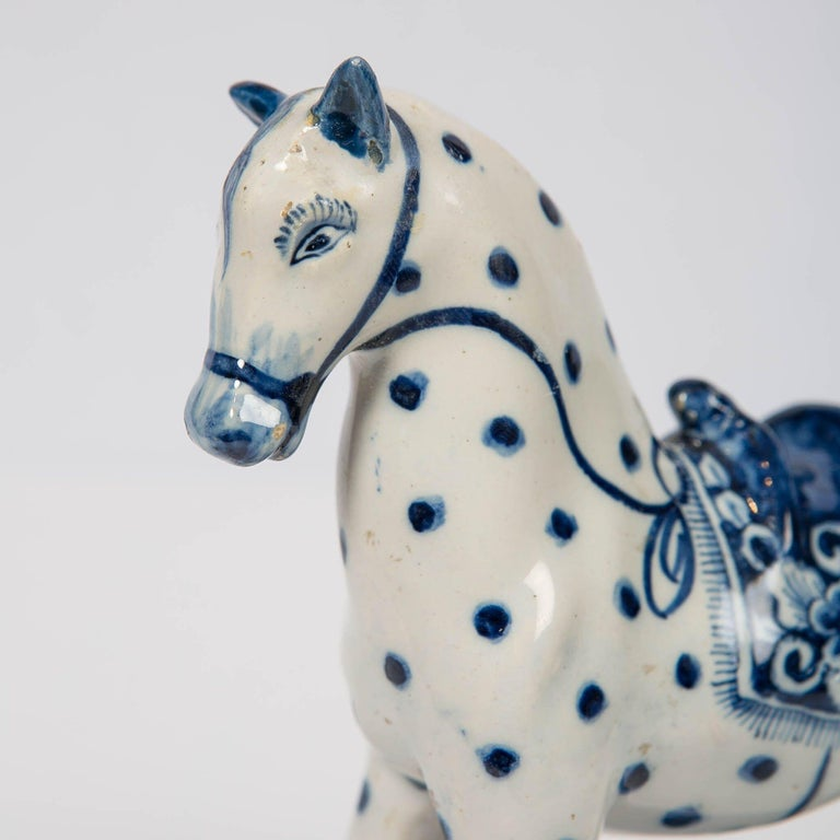 Provenance: Collection Vecht Amsterdam A lovely 18th century Dutch Delft blue and white spotted horse is modeled prancing on a rectangular blue base. His ears point straight up; his head tilts slightly to one side as though he hears something. A