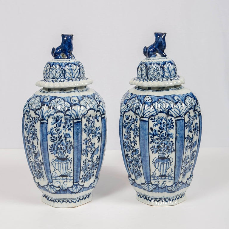 Rococo Dutch Delft Blue and White Jars with Lion Finials Made For Sale