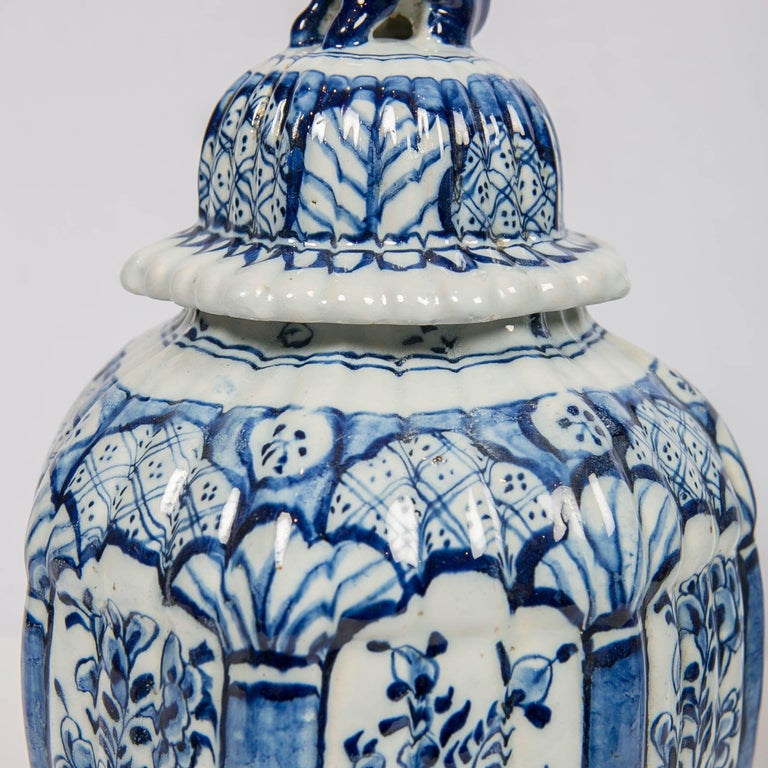 Dutch Delft Blue and White Jars with Lion Finials Made For Sale 1