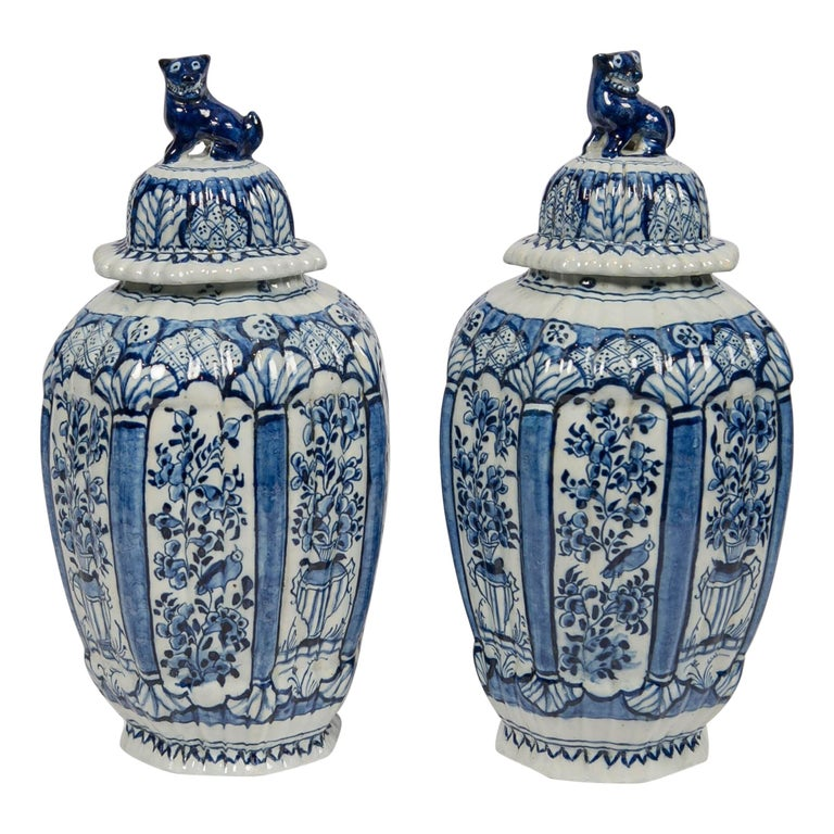 Dutch Delft Blue and White Jars with Lion Finials Made For Sale