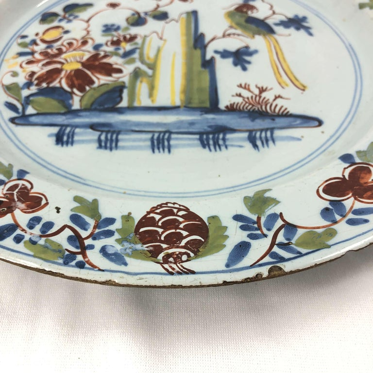 18th century Dutch delft polychrome round hand painted charger.