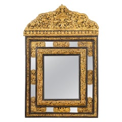 Dutch Ebonized and Repousse Gilt-Metal Cushion Mirror